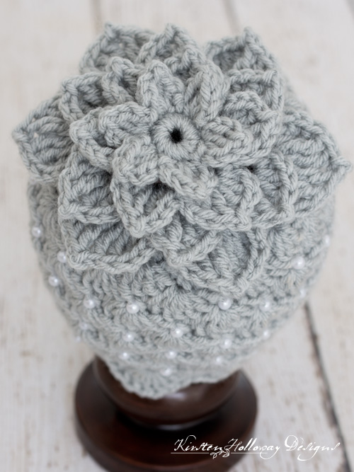 close-up of lily flower topped baby hat crochet pattern with beads.