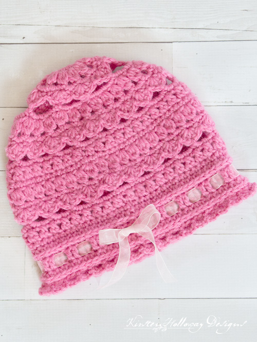 Eden Cloche, a lacy crochet child's hat pattern.