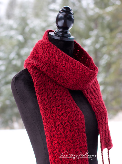 The Cranberry Twist Scarf is a beautiful free, crochet pattern for ladies and teens, with fluffy pom-poms made from faux fur. A quick tutorial for making your own Pom-poms is included.