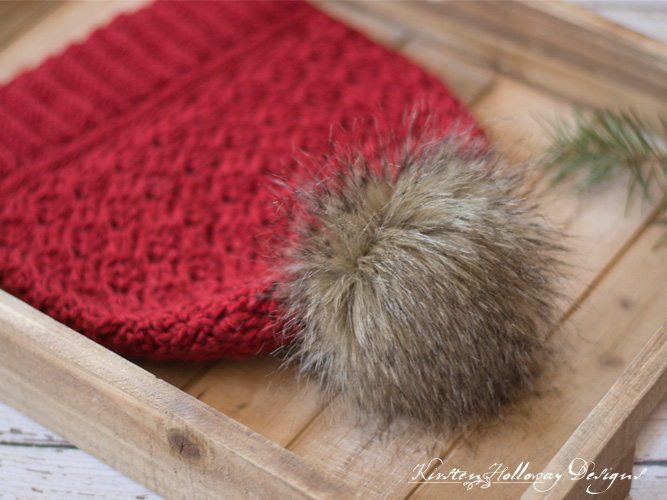 Cranberry Twist Slouch hat, a beautiful free, crochet pattern for ladies and teens, with pom-poms.
