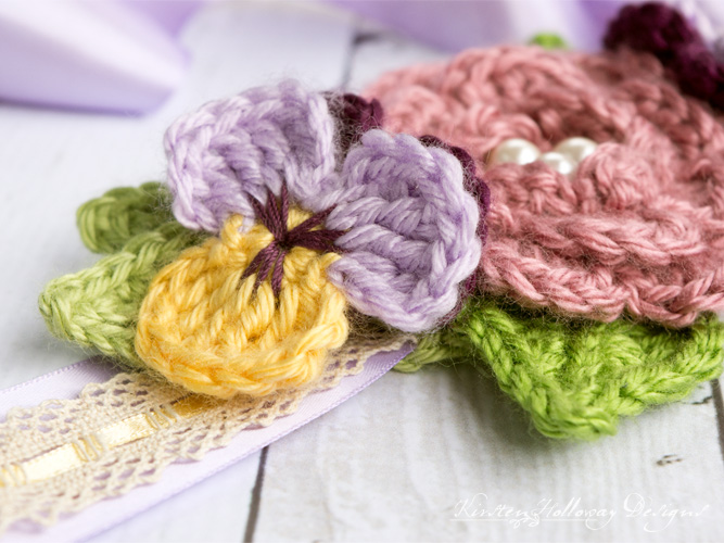April Flowers Crochet Headband, or hair accessory for girls, and women. A Beautiful, free crochet pattern with flowers for spring and summer. Works with long or short hair!