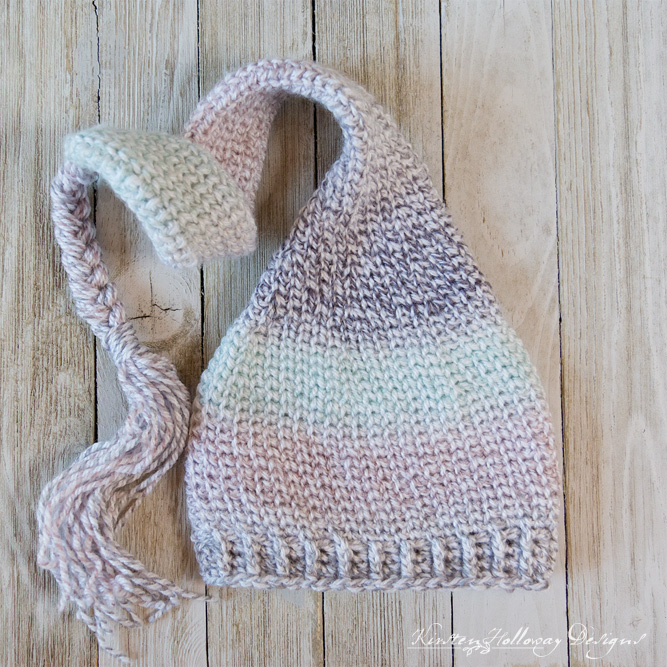 Sugar Plum Dreams is a crochet elf hat pattern for babies that looks knit! The stitch is easy to master, and you'll work up this simple Christmas hat quick as a wink!
