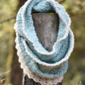 Crochet an easy infinity scarf and add a beautiful lace trim to the edge with this free crochet pattern.