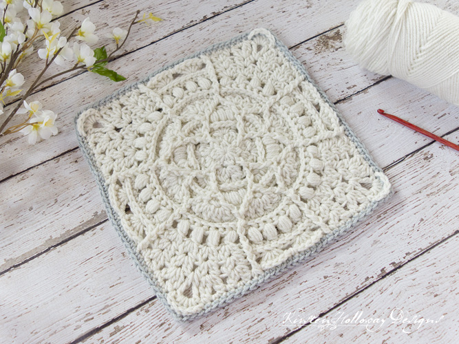 "Free crochet ""granny"" square pattern featuring a magnolia flower-inspired design in the center. Part of the Moogly Afghan CAL."