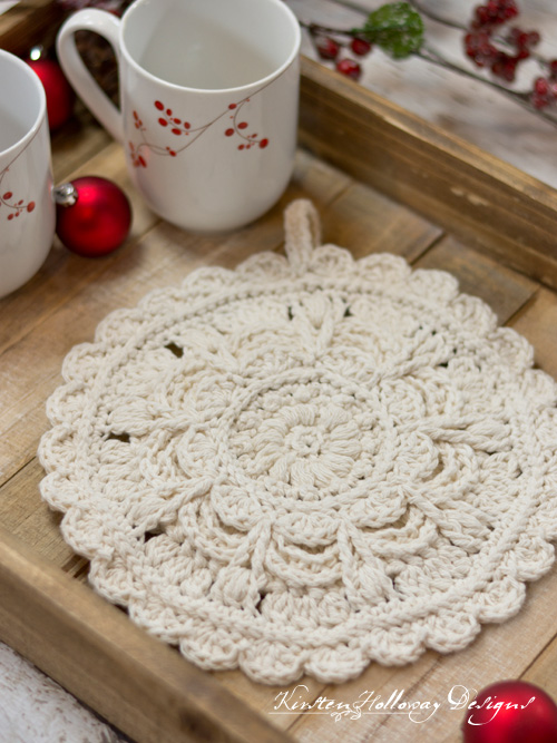 Crochet an elegant hot pad to set your holiday dishes on this year. This beautiful round hot pad is thick yet lacy protecting your table and counters from too-hot dishes.