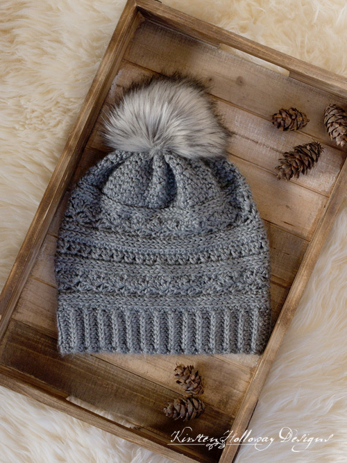 Crochet a winter slouch hat for women with this free crochet slouch hat pattern. Instructions for making a faux fur pom-pom are included.
