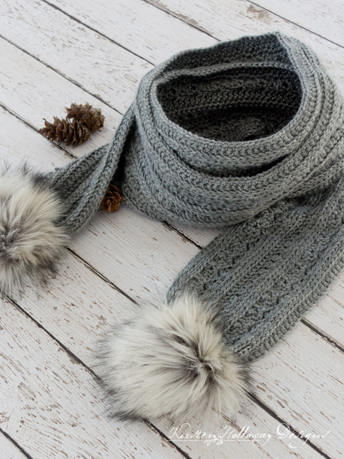 The free November Twilight winter scarf is a unique, textured crochet pattern that also includes a tutorial for making furry pom-poms.