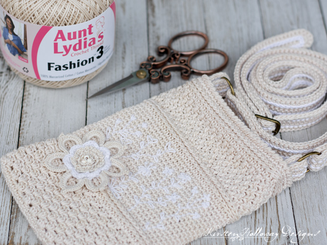 Embroidered Cell Phone purse or punch with strap and pocket, free crochet pattern.