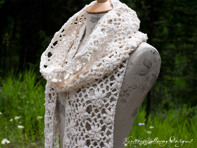 Close-up of crochet flower lace details.