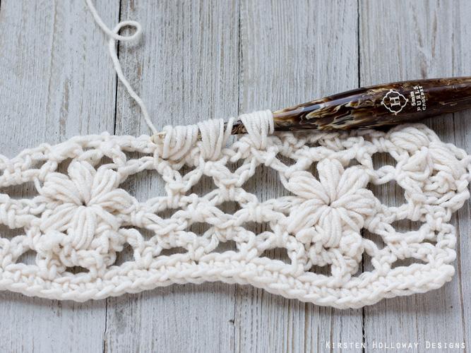 Crochet flower tutorial step 25 - creating a 3pufftog.