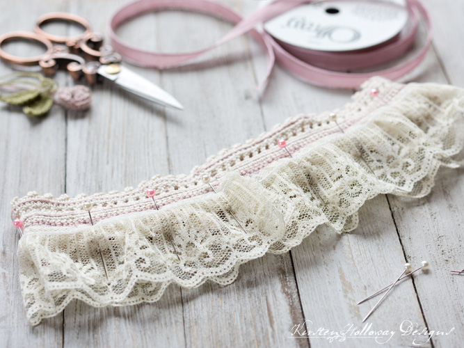 Pinning the lace ruffle on your wedding garter and pinning the ruffle in place.