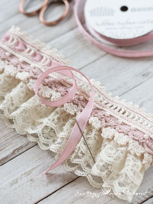 Threading your ribbon through the top of the garter.