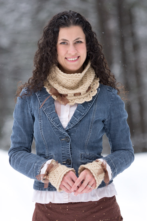 Welcome! I share a little about me and the motives behind my designs on this page. The crochet set I am wearing in this picture is my Ribbons and Grace Cowl and hand warmers, which can be found on this site.