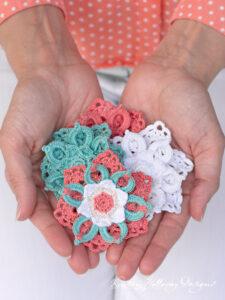 Crochet tropical flower hair clips make a pretty hair accessory for little girls. Close-up.