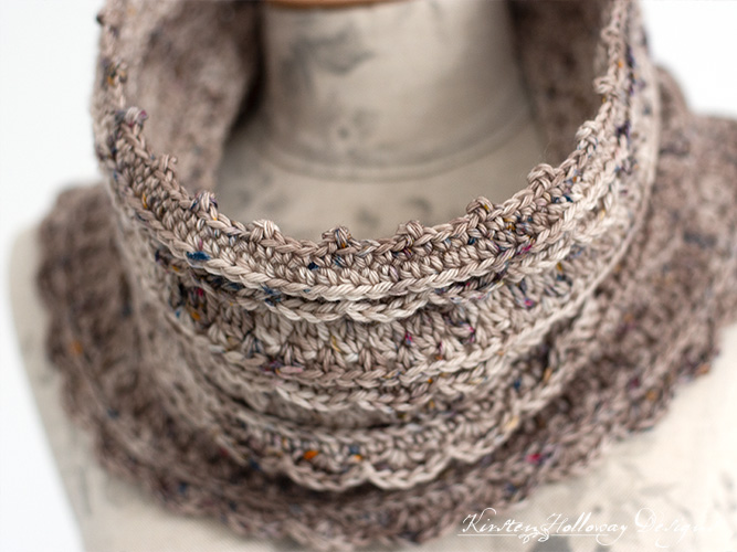 A Close-up of the Layer Cake lace cowl crochet pattern showing some of the yummy stitch details.