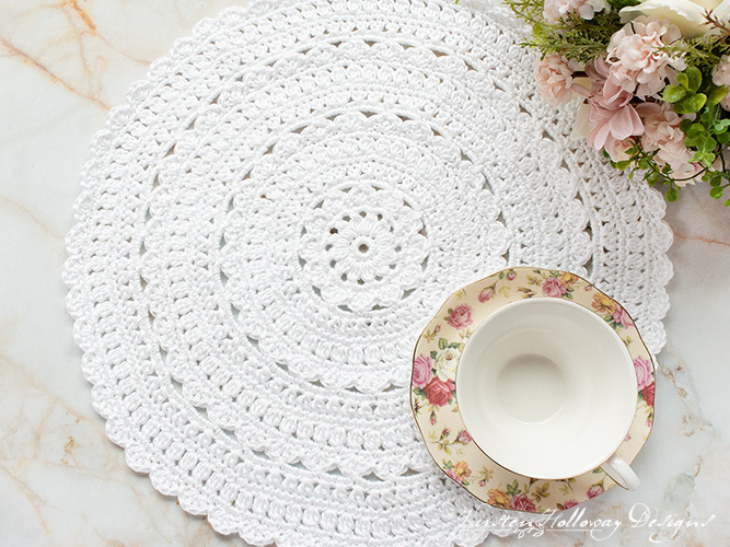Crochet a pretty round placemat with lacy details with this free crochet pattern.