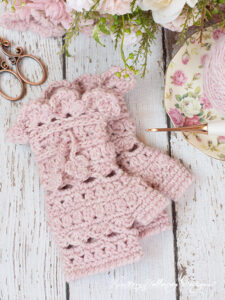 The Secret Garden crochet fingerless gloves pattern is lacy, yet warm and full of Victorian charm.