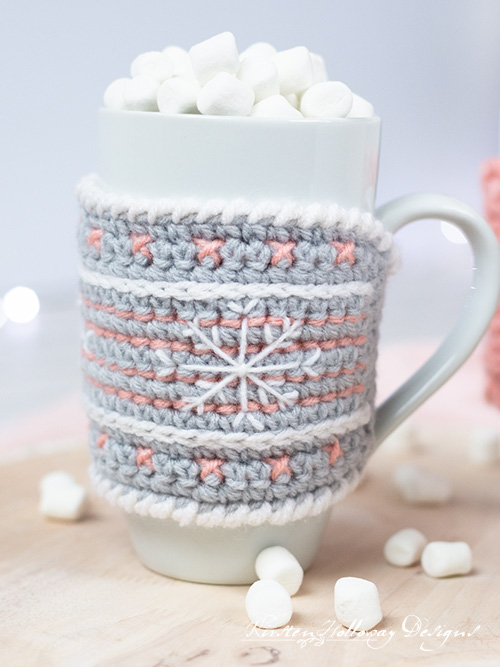 Embroider a a festive snowflake on your mug cozy.