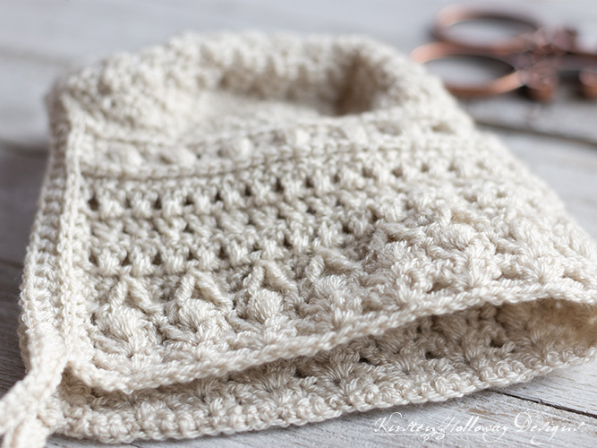 Crochet stitch detail on the front of the classic baby bonnet pattern.