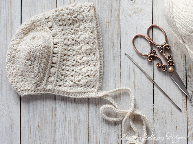 Crochet a classic T-shaped baby bonnet with this free pattern.