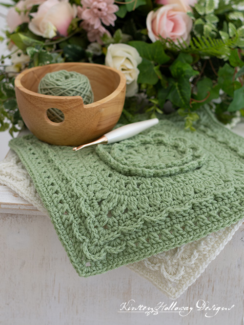 """The secret garden square is a lacy 12"""" afghan block pattern with lots of floral details. Free crochet pattern."""