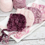 Crochet a cute baby bonnet pattern with lots of texture.
