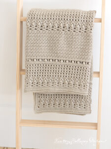 Crochet a classic baby blanket with this free pattern.