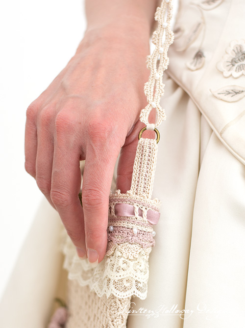 Close-up detail showing the strap assembly of the vintage style wedding bag.