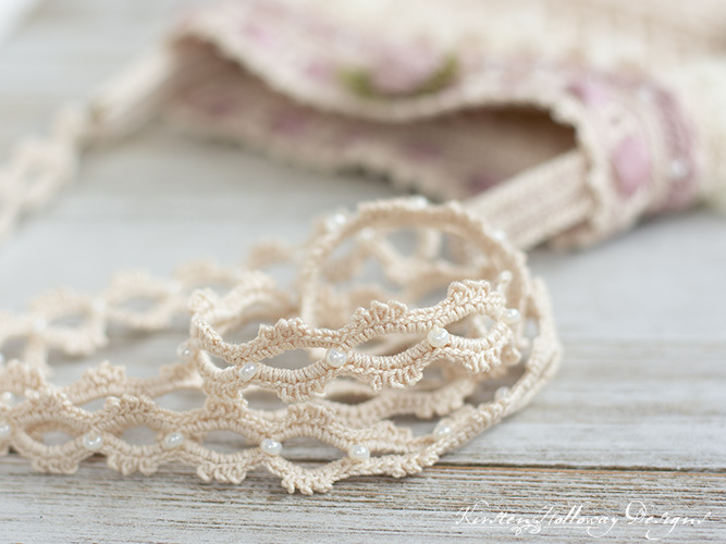 Close-up picture showing the beads on the lacy strap of this vintage style crochet wedding bag for the bride.